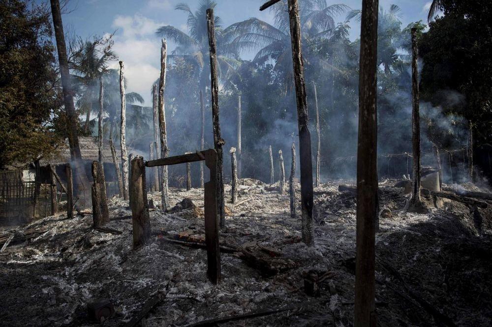 Smoldering debris of burned houses in Warpait village, a Muslim village in Maungdaw located in Rakhine State.