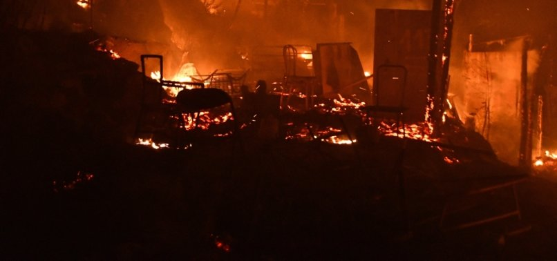 FIRE BREAKS OUT AT GREEK MIGRANT CAMP, FORCING EVACUATION