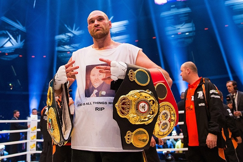 Tyson Fury celebrating in the ring after his victory over Ukraine's Vladimir Klitschko in their world heavyweight title bout in Duesseldorf, Germany, Nov. 28, 2015. (EPA Photo)