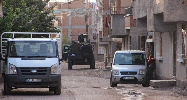 Armored police vehicle waiting outside the buildings that police look for suspected Daesh terrorists in counter terror operation launched at early hours, Oct. 19, 2016. (Ihlas News Agency Photo)