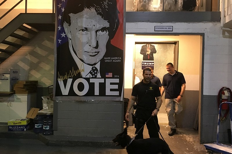 Secret Service agents get off an elevator near an campaign image of Republican presidential nominee Donald Trump on the wall in the basement at Trump Tower in the Manhattan borough of New York, U.S. (Reuters Photo)