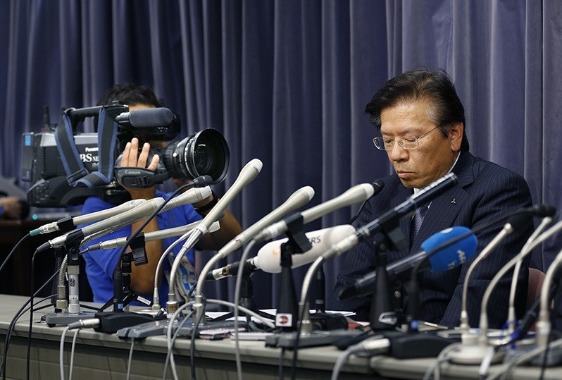 Mitsubishi Motors Corp. President Tetsuro Aikawa listens to a reporter's question during a press conference in Tokyo. (AP Photo)