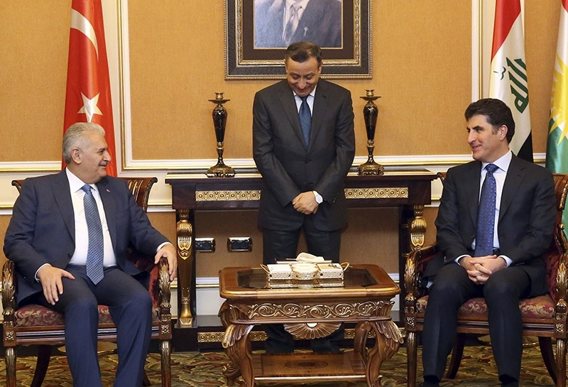 Prime Minister Binali Yu0131ldu0131ru0131m, left, and KRG Prime Minister Nechirvan Barzani speak during a meeting in Irbil, Iraq, Sunday, Jan. 8, 2916 (AP Photo)