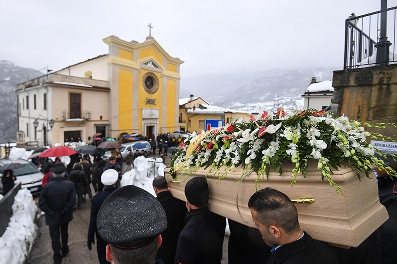 The coffin of Alessandro Giancaterino, one of the victims of the avalanche which buried Hotel Rigopiano, is carried during the funeral service in Farindola, central Italy, Jan. 24, 2017. (AP Photo)