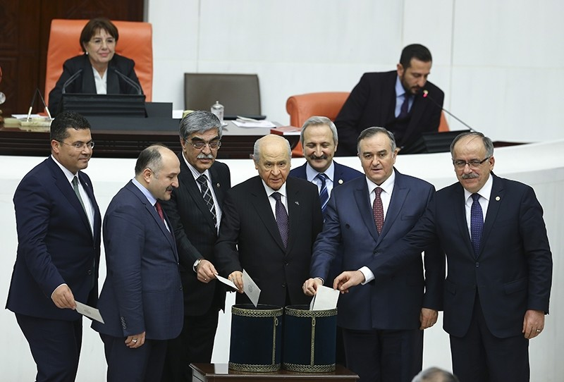 MHP Chair Devlet Bahu00e7eli and MHP lawmakers casting their ballots during the vote for constitutional change at the Turkish parliament (AA Photo)